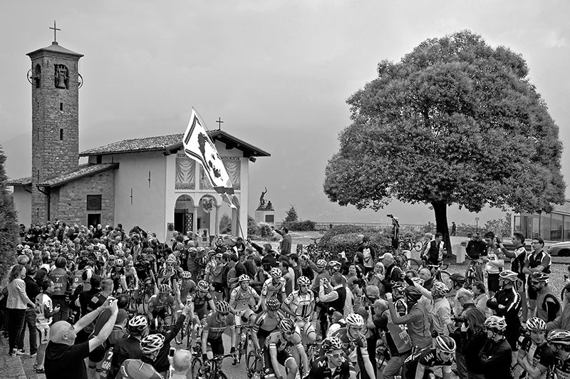 Peleton Passing the Madonna del Ghisallo Chapel, Il Lombardia 2014, Dan Martin (bottom left)
